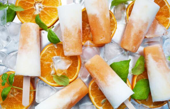 Homemade frozen yogurt cantaloupe popsicles