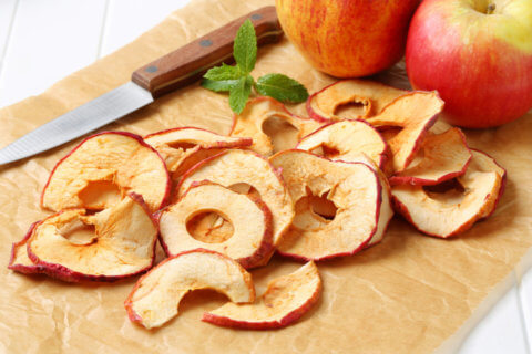 Apple chips on baking parchment paper