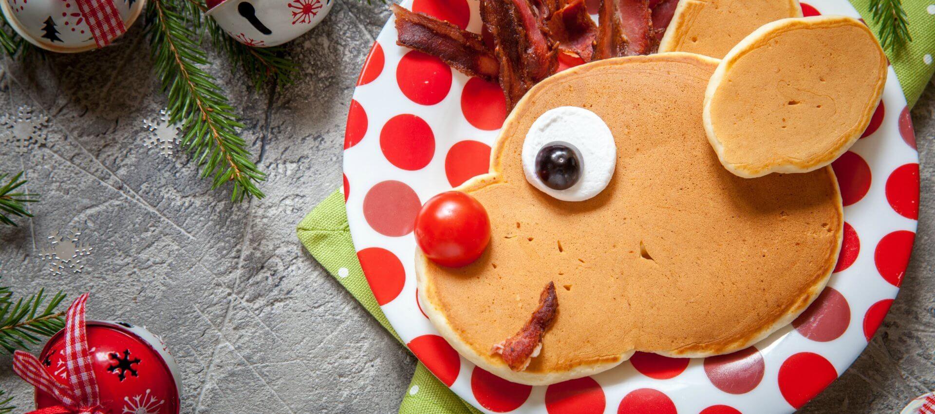 Christmas fun food for kids. Reindeer pancake for breakfast