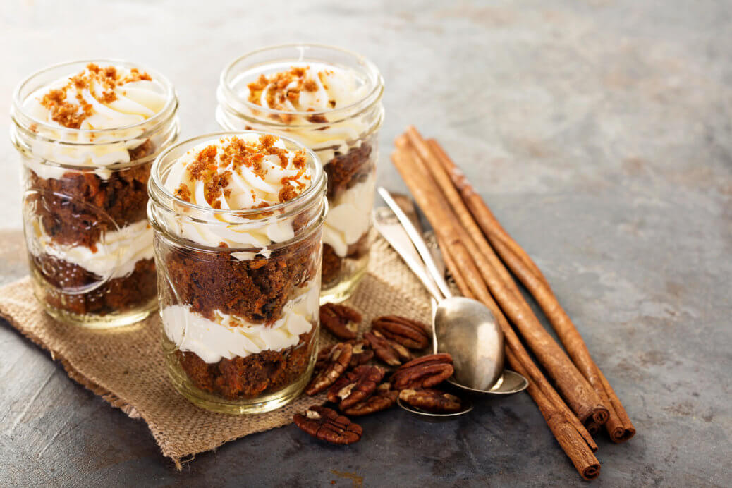 Pumpkin spice cake layered in a jar topped with White Chocolate Caramel Latte Cream