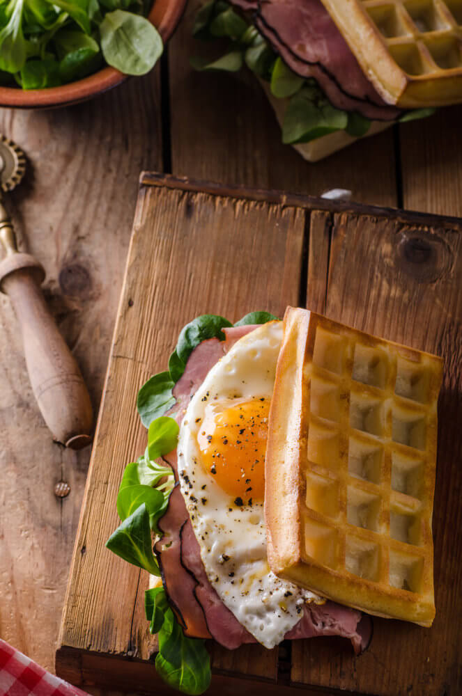 Waffles sandwich with eggs and lettuce old style sandwich
