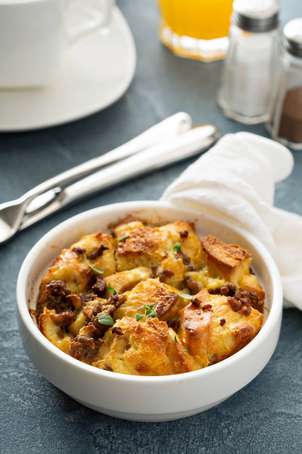 Breakfast strata with cheese and sausage. Slow Cooker Recipe