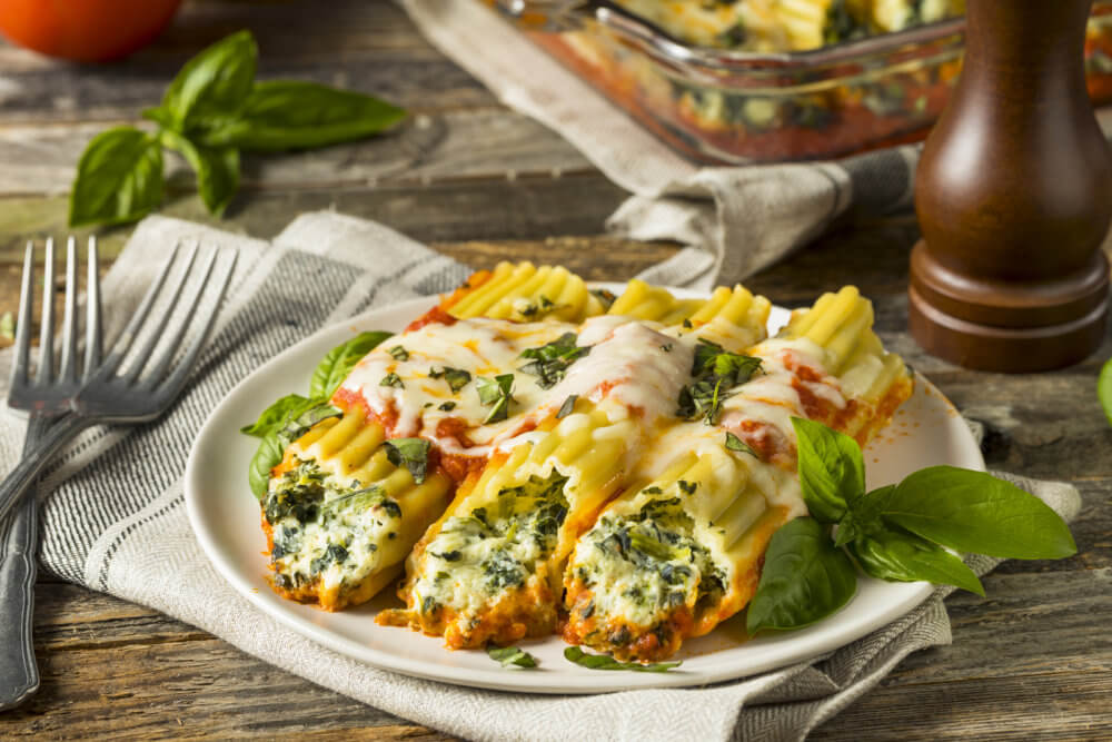 Homemade Stuffed Ricotta and Spinach Manicotti with Basil